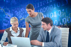 Composite image of business people using laptop Royalty Free Stock Photo