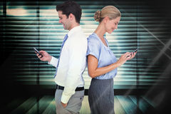 Composite image of business people using smartphone back to back Stock Images