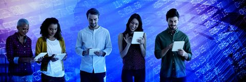 Composite image of business people using tablet against white background stock image
