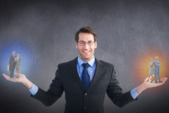 Composite image of business people using tablet computer. Business people using tablet computer  against grey room Stock Photos