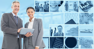 Composite image of business people using tablet computer Royalty Free Stock Images
