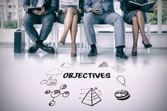 Composite image of business people waiting to be called into interview. Business people waiting to be called into interview against objectives text surrounded by Stock Photo
