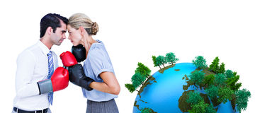 Composite image of business people wearing and boxing red gloves Royalty Free Stock Photography