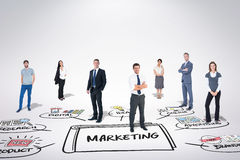 Composite image of business team. Business team against marketing doodle stock photography