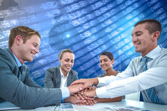 Composite image of business team celebrating a good job Royalty Free Stock Images