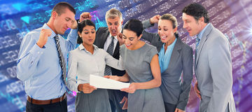 Composite image of business team celebrating a new contract Royalty Free Stock Images