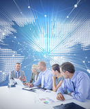 Composite image of business team having a meeting Royalty Free Stock Images