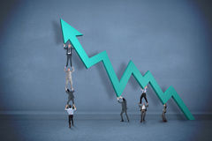 Composite image of business team holding up arrow Stock Photos