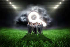 Composite image of business team looking at camera Stock Photos
