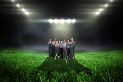 Composite image of business team looking at camera Stock Image