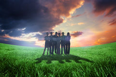 Composite image of business team looking at camera Royalty Free Stock Photography