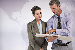 Composite image of business team looking at folder Stock Photography