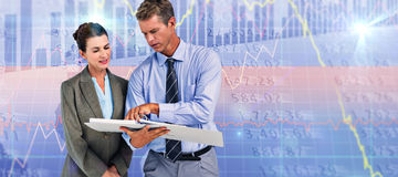 Composite image of business team looking at folder. Business team looking at folder against stocks and shares Royalty Free Stock Photo