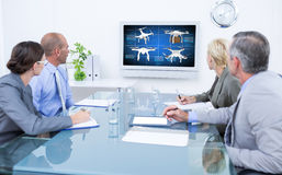 Composite image of business team looking at time clock Royalty Free Stock Photo