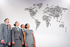 Composite image of business team looking up. Business team looking up against grey background Stock Image
