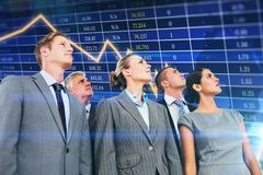 Composite image of business team looking up Royalty Free Stock Photo