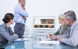 Composite image of business team looking at white screen Royalty Free Stock Images