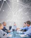 Composite image of business team during meeting Stock Photos