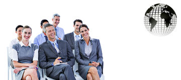 Composite image of business team during a meeting Stock Photography
