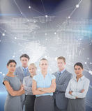 Composite image of business team smiling at camera Royalty Free Stock Photography