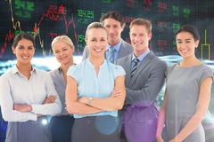 Composite image of business team smiling at camera Royalty Free Stock Photos