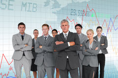 Composite image of business team standing arms crossed Stock Images