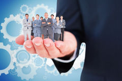 Composite image of business team standing arms crossed Stock Photography