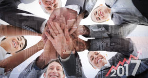 Composite image of business team standing hands together Stock Photography