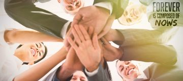 Composite image of business team standing hands together. Business team standing hands together against forever is composed of nows Stock Photo