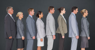 Composite image of business team standing in row stock image