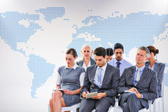 Composite image of business team taking notes during conference Royalty Free Stock Image