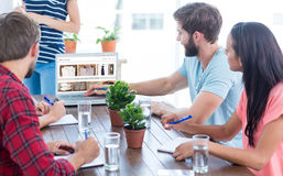 Composite image of business team using a laptop Royalty Free Stock Image