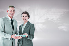 Composite image of business team using tablet pc Royalty Free Stock Photos