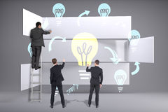 Composite image of business team writing Stock Image