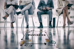 Composite image of business text surrounded by various  icons. Business text surrounded by various  icons against group of well dressed business people waiting Stock Image