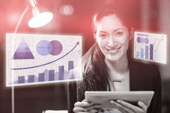 Composite image of business woman with a digital tablet against graph. Graph against businesswoman holding digital tablet Royalty Free Stock Photography