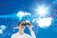 Composite image of business woman  looking through binoculars Royalty Free Stock Photos