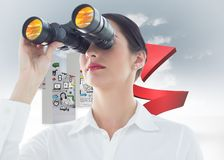 Composite image of business woman  looking through binoculars Stock Image