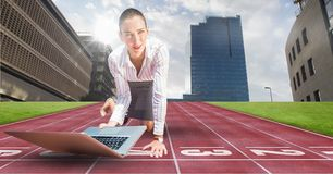 Composite image of business woman using laptop Royalty Free Stock Image