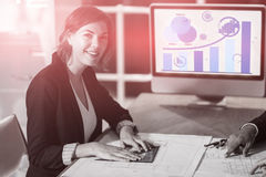 Composite image of business woman working on graph. Graph against portrait of businesswoman with blueprint Royalty Free Stock Images