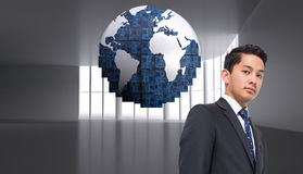 Composite image of  businessman against globe on abstract background Stock Photos