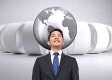Composite image of businessman against grey abstract background Royalty Free Stock Photo