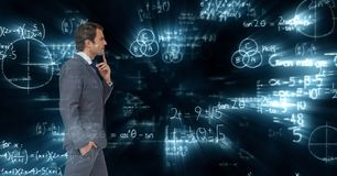 Composite image of businessman against mathematics background royalty free stock photography