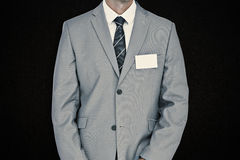 Composite image of businessman with badge Royalty Free Stock Photography