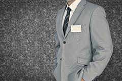 Composite image of businessman with badge Royalty Free Stock Image