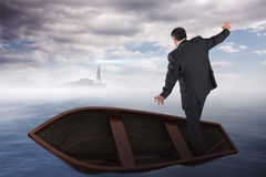 Composite image of businessman balancing in boat Royalty Free Stock Photo