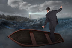 Composite image of businessman balancing in boat Royalty Free Stock Images