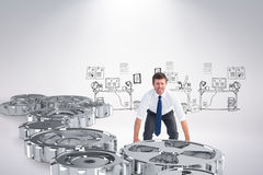 Composite image of businessman bending and lifting Stock Images