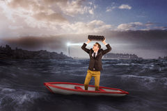 Composite image of businessman in boat Royalty Free Stock Photo