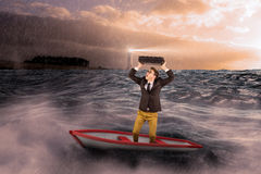 Composite image of businessman in boat Stock Photography